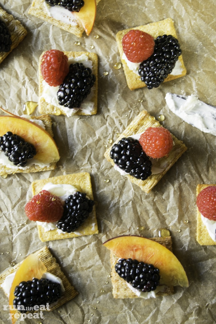 Crackers paired with tangy goat cheese and topped seasonal fresh fruit. A light and healthy snack!