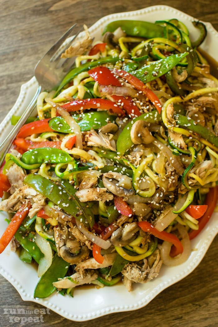 There's nothing worse than boring weeknight dinners. Kick it up a notch with this flavorful, healthy Asian inspired chicken and veggie dish! Find the recipe at runlifteatrepeat.com!