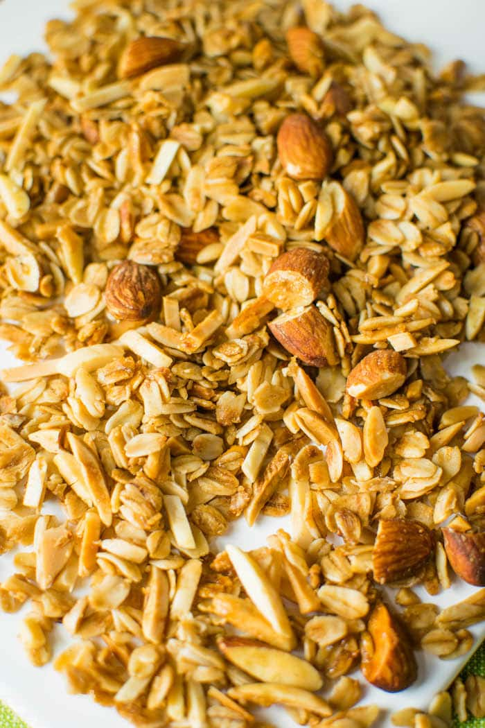 """Simple, crunchy granola exploding with vanilla flavor. Ditch the store-bough and make this """"feel good"""" granola ASAP! Find the recipe at runlifteatrepeat.com!"""