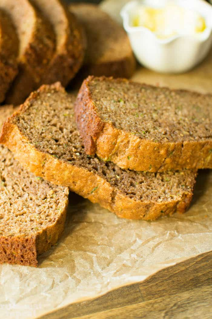 This moist and flavorful zucchini bread will knock your socks off. No butter, no oil, zero refined sugar and 100% whole wheat! Find it at runlifteatrepeat.com!