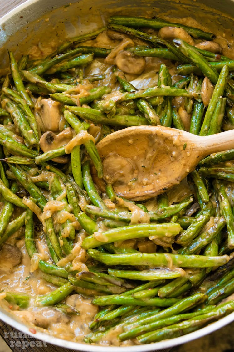 Creamy, comforting, flavorful green bean casserole made completely from scratch using only fresh ingredients. The perfect side disk for Thanksgiving! Find the recipe at runlifteatrepeat.com!