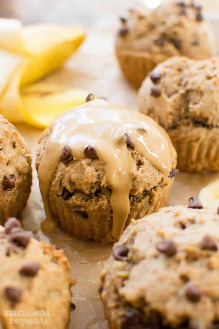 These 150 calorie peanut butter banana muffins taste like the real deal. Sweetened with just honey and mashed bananas! Find the recipe at runlifteatrepeat.com!