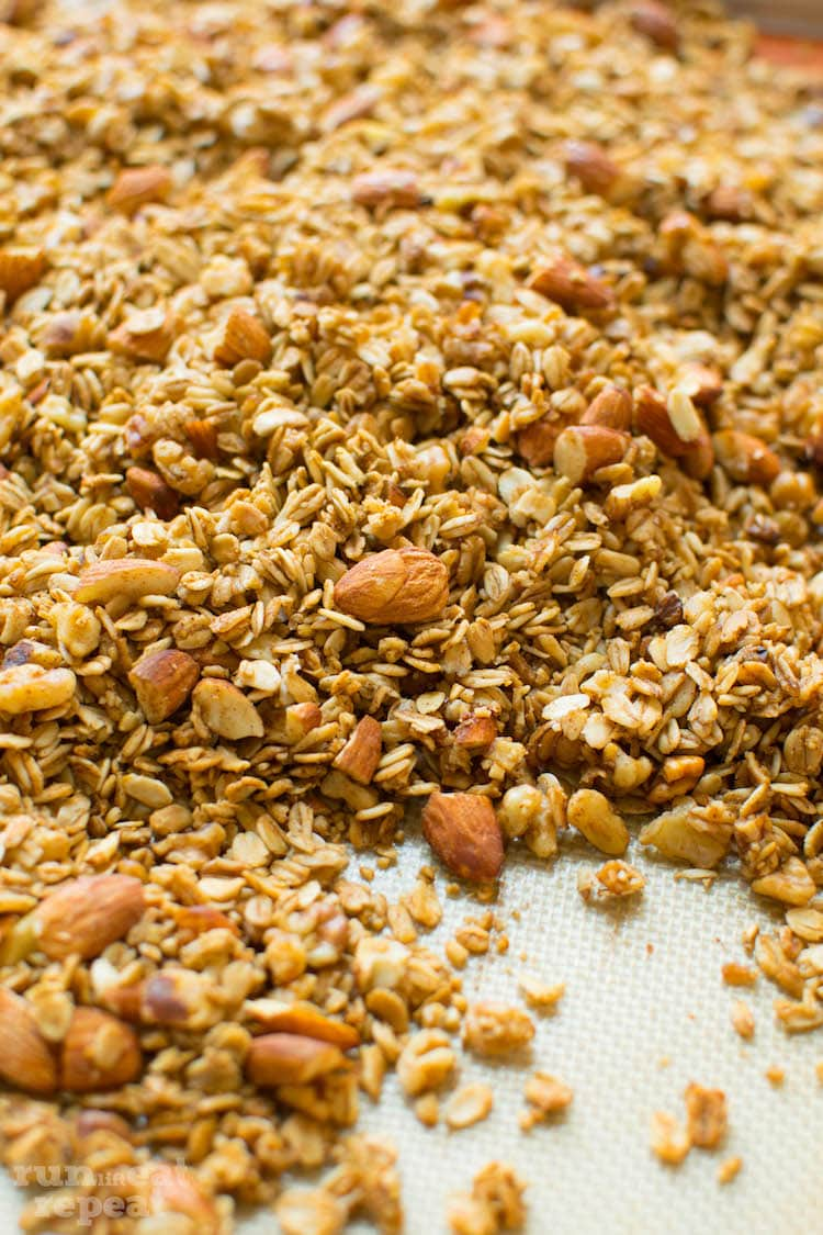 Crunchy granola exploding with vanilla and almond flavors. Ditch store-bought, homemade granola is easier than you think! Find the recipe at runlifteatrepeat.com!