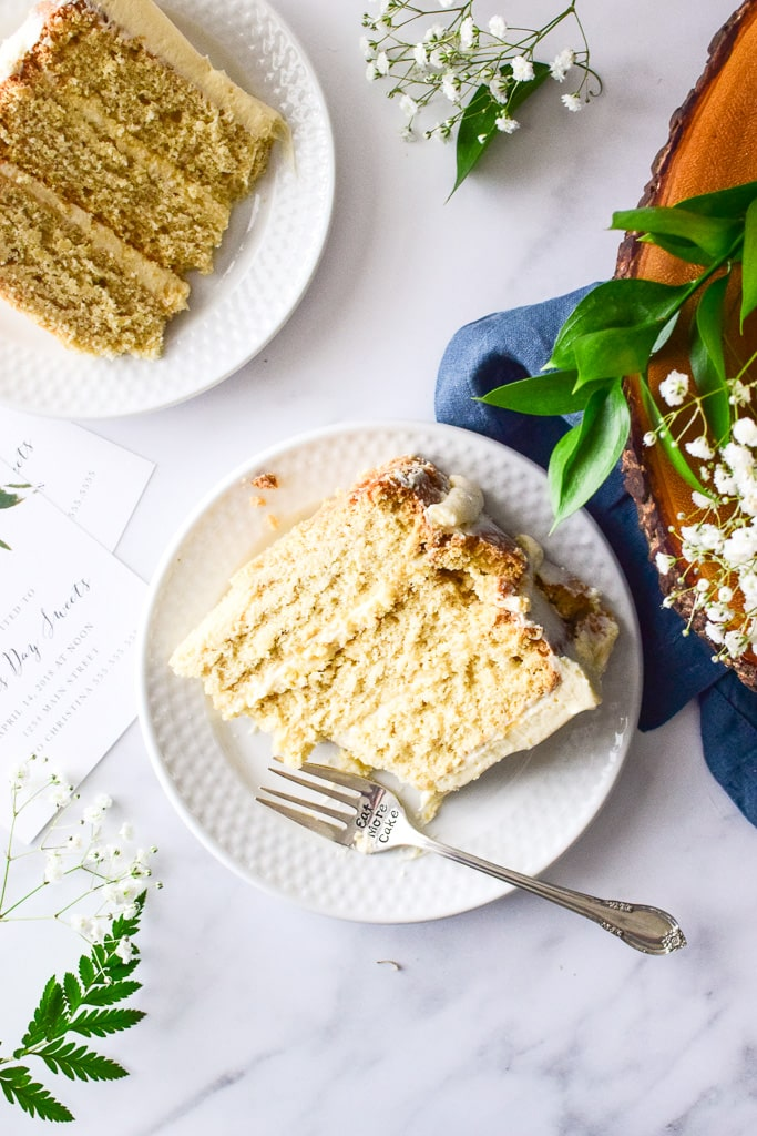 The minimal frosting on the outside exposes the cake layers — perfect for Spring festivities! Find the recipe at runlifteatrepeat.com!