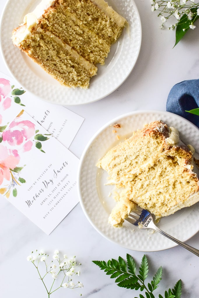 The minimal frosting on the outside exposes the cake layers— perfect for Spring festivities! Find the recipe at runlifteatrepeat.com!