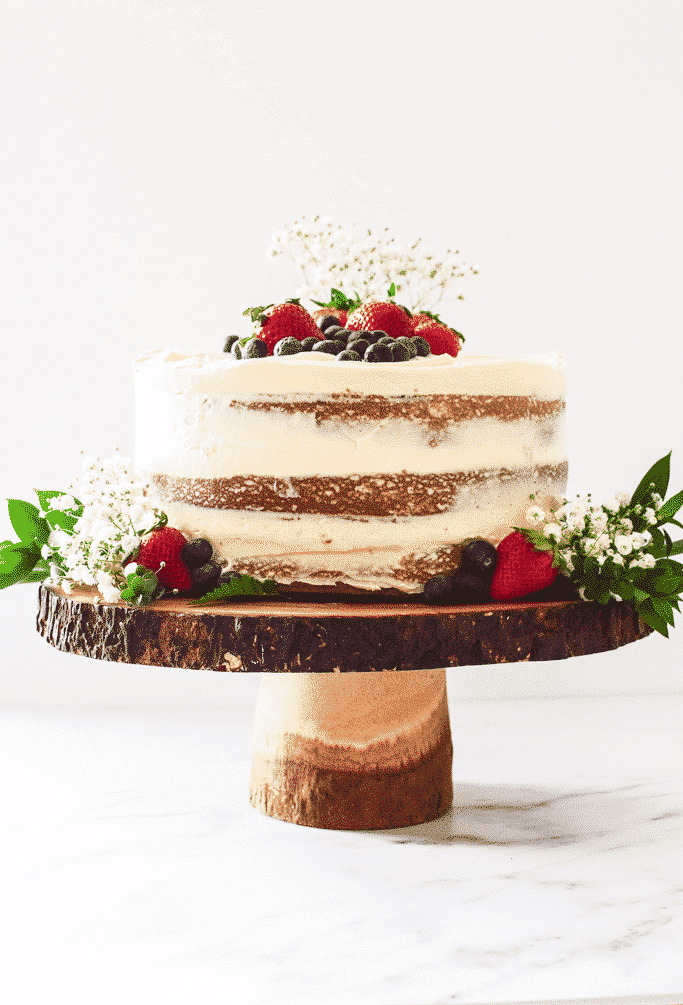 The minimal frosting on the outside exposes the cake layers— perfect for Spring! Find the recipe at runlifteatrepeat.com!