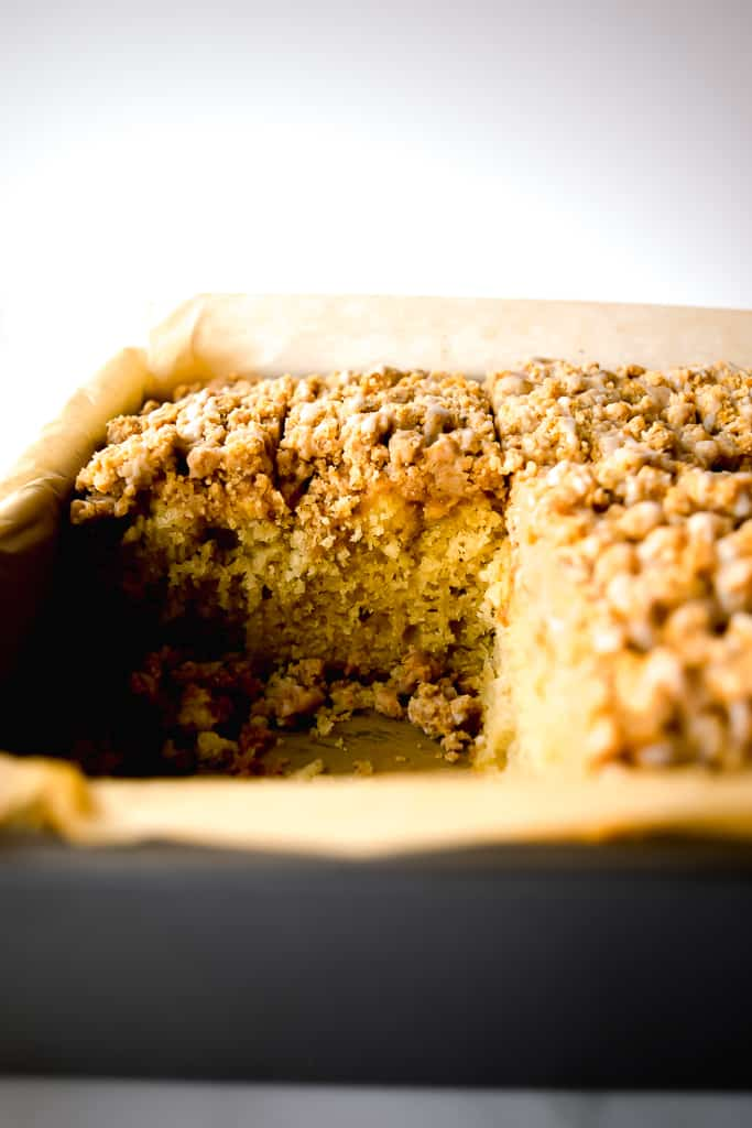 A soft, tender, easy-to-make crumb cake, topped with cinnamon apples and heavy on the crumbs! Get the recipe at runlifteatrepeat.com!