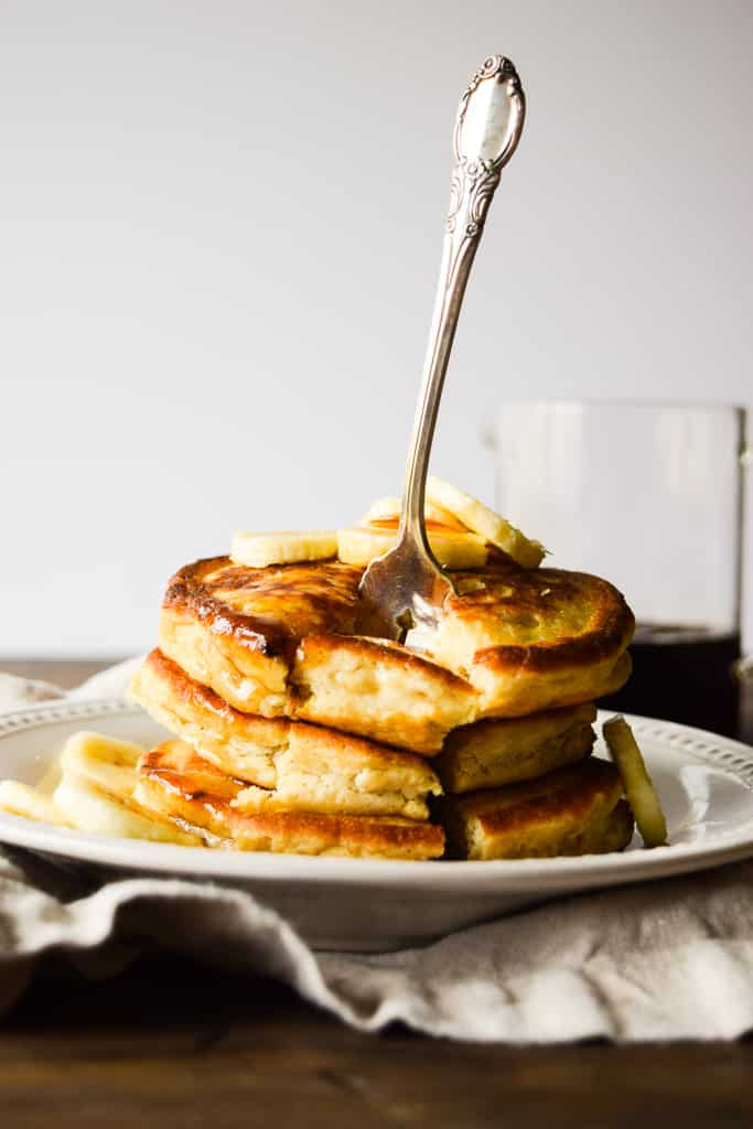 These fluffy and light gluten-free pancakes are super filling and packed with fresh bananas!