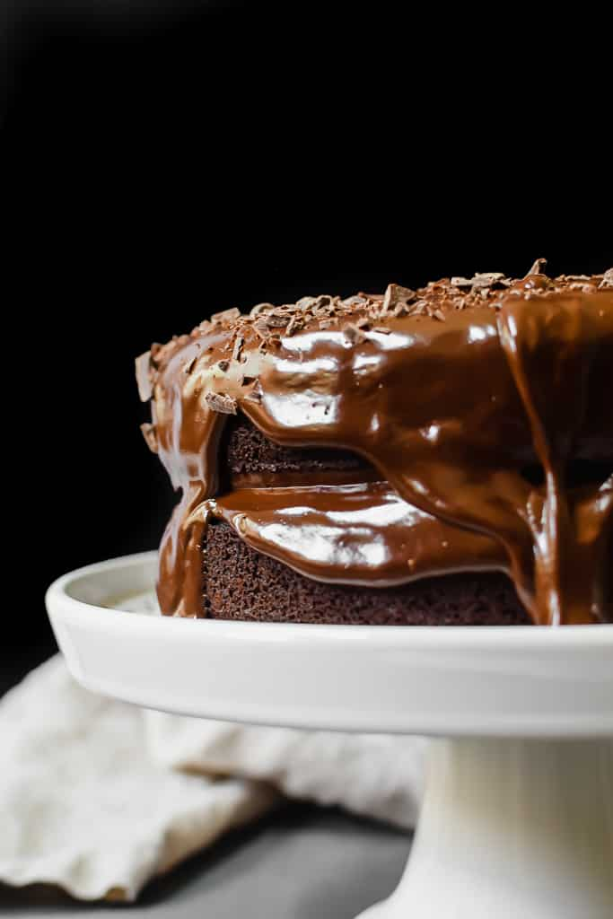 My favorite homemade paleo chocolate cake recipe. It's the richest, the fudgiest and a crowd pleaser!