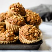 Hearty and satisfying whole wheat muffins filled with bananas and tons of cinnamon! Find the recipe at runlifteatrepeat.com.