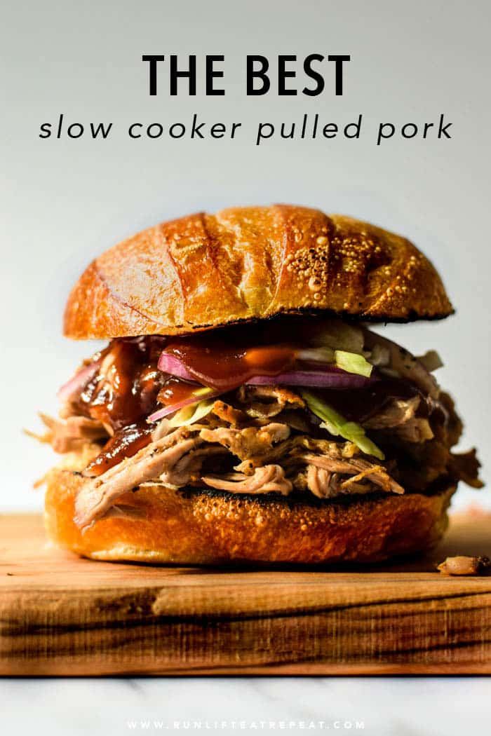 The BEST slow cooker pulled pork that you will ever make! Lots of flavor and can feed a crowd! Find the recipe at runlifteatrepeat.com.