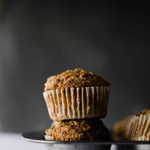 Healthy whole wheat muffins filled with shredded apples, tons of cinnamon spice and zero refined sugar! Find the recipe at runlifteatrepeat.com. #wholewheatmuffins #muffins #breakfast #apple #cinnamon #dairyfree