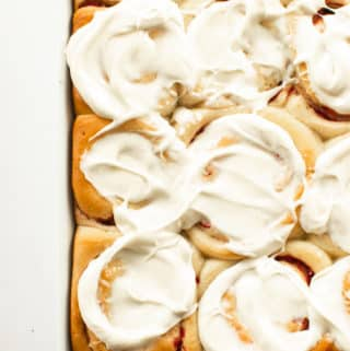 These soft & fluffy homemade sweet rolls are filled with strawberries and topped with a thick layer of cream cheese icing. Breakfast has never tasted so good! #breakfast #cinnamonrolls #sweetrolls