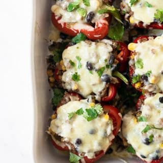 If you're searching for an easy weeknight dinner recipe that satisfies and one that the family will love, look no further. These Mexican Stuffed Peppers are packed with flavor from the spices and come together in no time! #dinner #recipe #mexican #healthy #easy