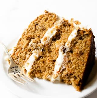 This carrot cake recipe is incredibly moist, bursting with spice flavor, and frosted with a smooth and creamy cream cheese frosting. It's a recipe that you'll be making over and over again.
