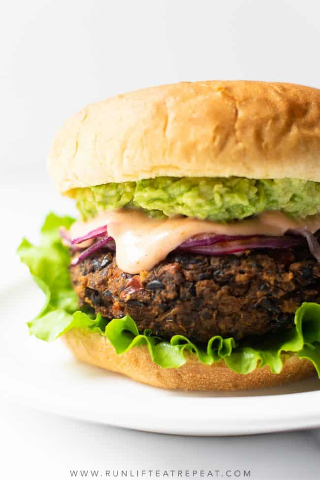 If you're craving big flavor in a burger, you need to make these black bean burgers. With 5 star reviews from taste testers, I'm certain that you'll love this black bean burger recipe just as much as I do!