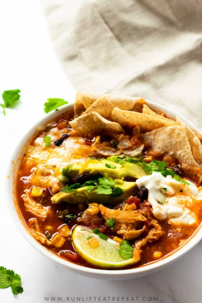 This chicken tortilla soup recipe is easy, homemade, and satisfying. The perfect dinner for those cold nights. Add your favorite toppings and adjust the spice level to your liking! It freezes perfectly and keeps for lunches all week.