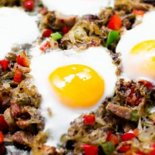 This super simple crispy breakfast potato hash is prepared in a skillet and combines all the breakfast classics into one dish! There's potatoes, peppers, onions, sausage, and eggs. One stop for all your breakfast needs!