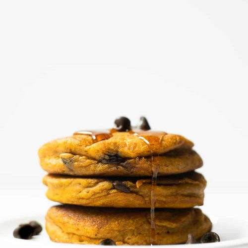 These homemade pumpkin chocolate chip pancakes are thick, moist and flavored with those iconic fall spices we all know and love. Start off your fall mornings with a large stack of these pumpkin pancakes.