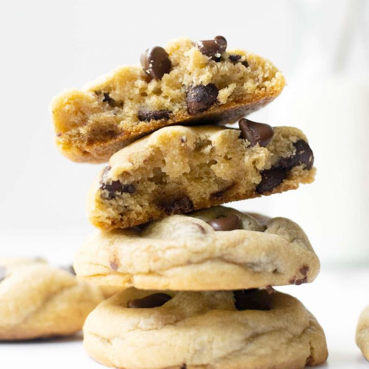 These big fat soft-baked chocolate chip cookies are thick and slightly crispy around the edges. The secret for the chewiest chocolate chip cookie texture is more brown sugar than granulated sugar, an extra egg yolk, plus a little cornstarch! No chilling required!
