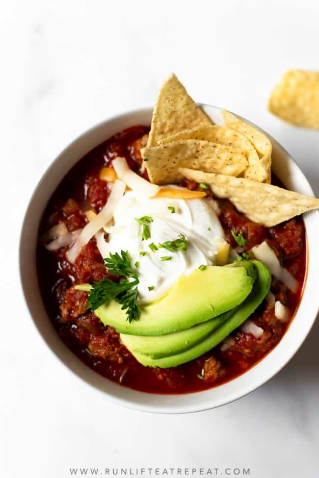 If you want a from scratch traditional chili recipe, look no further. This chili recipe is made with ground turkey (or beef), bell peppers, onion, tomatoes, beans, and a variety of spices. This is a feel-good, hearty, cozy dinner that everyone will love!