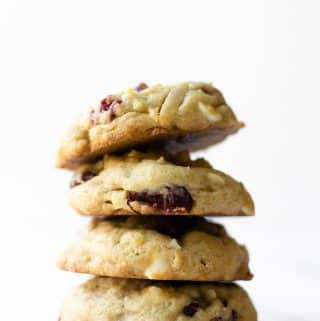 These cranberry almond white chocolate chip cookies are extra chewy and soft, using my go-to cookie base recipe. These are loaded with almonds, dried cranberries, and white chocolate chips. You won't be able to stop at one— get ready to be going back for more!