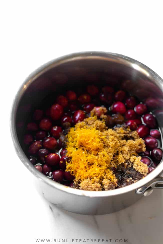 This is our family recipe for homemade cranberry sauce. The sauce is made from just 5 ingredients and ready in 15 minutes. It's flavored with a few secret ingredients that makes this cranberry sauce the best!