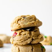 These monster cookies are filled with peanut butter, oats, chocolate chips, and M&Ms. These monster cookies are easy to make and produce a soft and thick cookie. And there's no dough chilling!