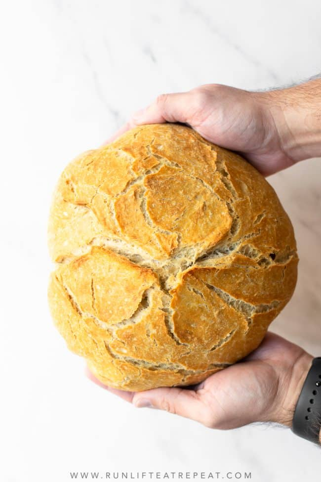 Making homemade bakery-style has never been easier. This extra crusty no knead bread is baked in a dutch oven and requires almost no hands-on work!