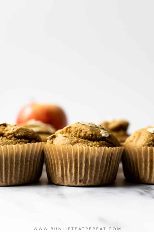 These easy and healthy apple banana oat muffins combine bananas, applesauce, oats and chopped apples. The batter comes together in a blender and the muffins freeze perfectly.