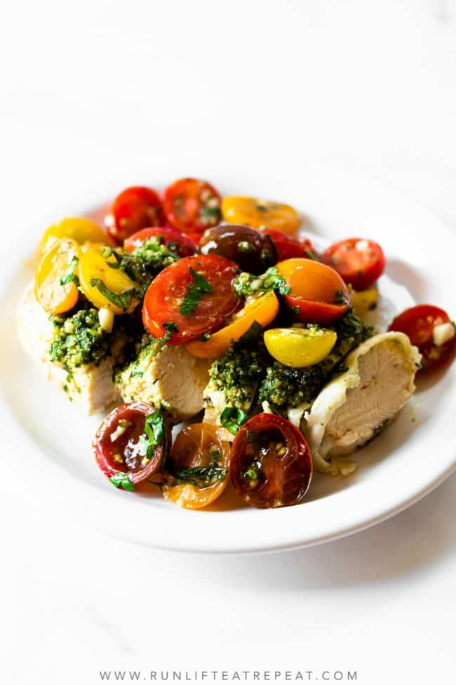 This pesto bruschetta chicken is made with simple feel-good ingredients and is on the table in 35 minutes! This recipe has layers of flavors from the pesto, to the bruschetta, to the chicken. It's a rave-worthy recipe that will be on repeat no matter the time of year!