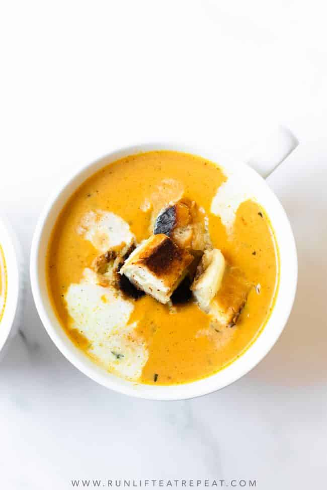 You won't be able to get enough of this creamy pumpkin soup topped with grilled cheese croutons. It's hands-down the easiest soup recipe and one of the most comforting soups that you'll ever have!