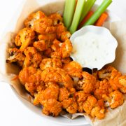 This buffalo cauliflower can be baked or made in the air fryer. This recipe is easy to make and delivers all of the same flavor of buffalo wings but in a lighter way! This buffalo cauliflower recipe will be the star of all other appetizers.