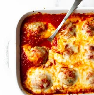 This recipe for oven baked meatballs is an easy weeknight dinner. The meatballs are made with ground turkey, a combination of spices and a few other basic ingredients. The meatballs are baked in the oven until tender and topped with shredded mozzarella cheese.