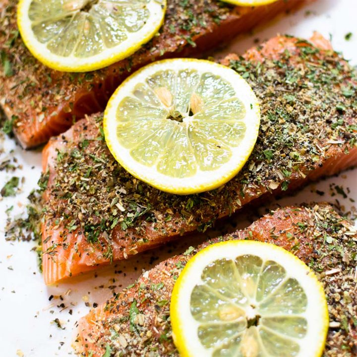This easy baked herb crusted salmon is guaranteed to impress. It's smothered in an herb mixture and is ready in under 35 minutes!