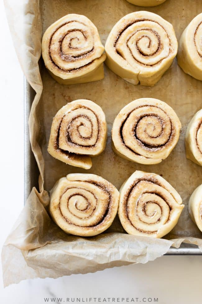 These homemade cinnamon rolls are soft and fluffy, filled with the most delicious cinnamon sugar swirl, have warm and gooey centers, slightly golden brown edges, and smothered in a generous amount of cream cheese frosting. Nothing beats this classic recipe!
