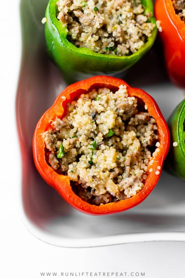 I'm singing all the songs for this sausage stuffed peppers recipe because it's THE dinner recipe to make this week. Featuring a flavorful filling that's made with ground sausage, onions, mushrooms, garlic, herbs, chicken broth, and quinoa. It's a hearty dinner recipe that the whole family will love!