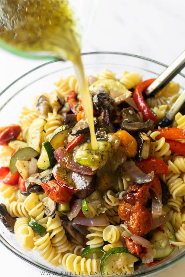 This roasted vegetable pasta salad is absolutely delicious and features seasonal vegetables. It's not only easy to make, but it's bursting with flavor from the homemade dressing, feeds a crowd, keeps for days in the refrigerator, and is a recipe that even meat lovers can't get enough of!