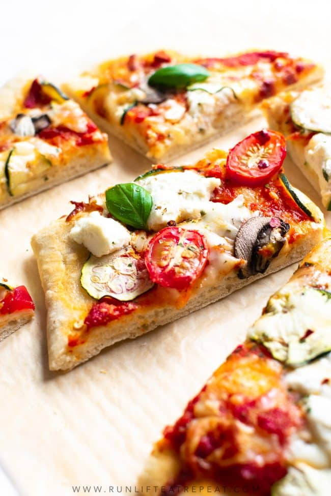 This zucchini, mushroom & tomato herbed ricotta flatbread pizza uses my favorite flatbread dough recipe. It's topped with herbed garlic ricotta cheese, zucchini, tomatoes, and a little fresh basil to finish it off. It's a dinner recipe that the entire family loves!